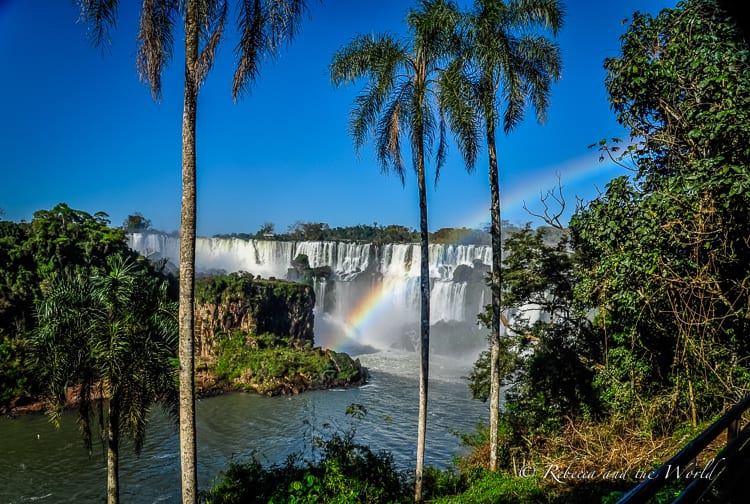 Should you visit Iguazu Falls Argentina or Brazil side? I say both! Read on for a guide on how to see both sides of the waterfalls, how to get here and where to stay. | #argentina #brazil #iguazufalls #nature #travelguide #waterfalls #puertoiguazu #fozdoiguazu #naturalwonders