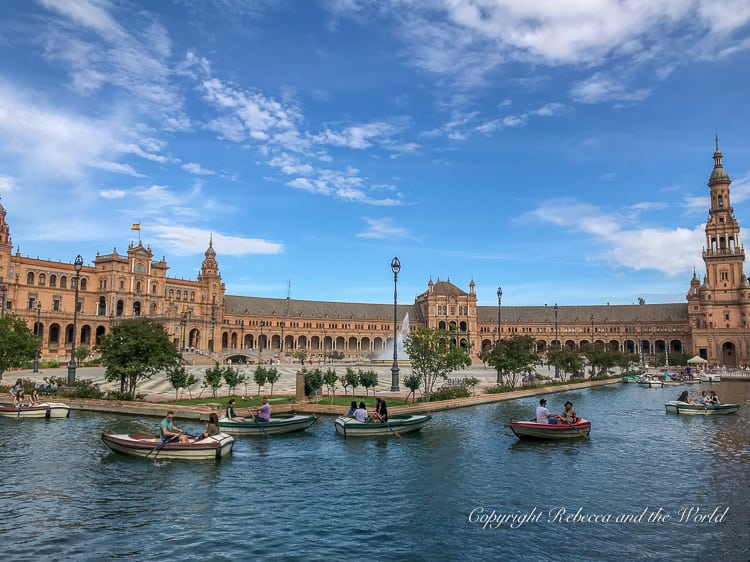 The Plaza de Espana in Seville, Spain, is one of the best places to visit in Seville - it's a beautiful plaza where you can even rowboat on the moat