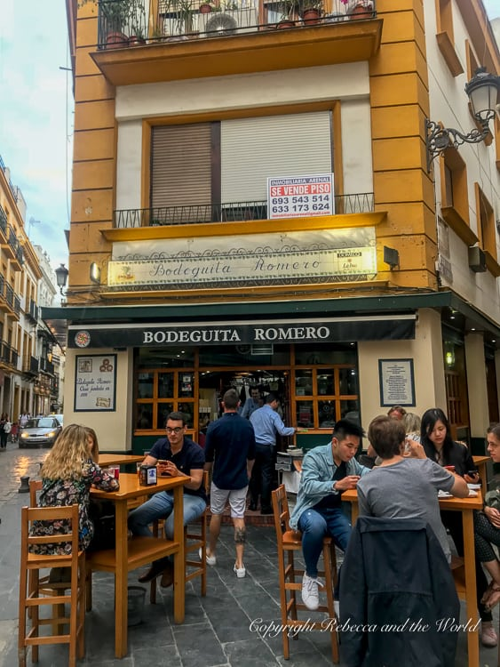 Bodeguita Romero is a fun tapas bar in Seville, Spain, with the tables inside and outside always full