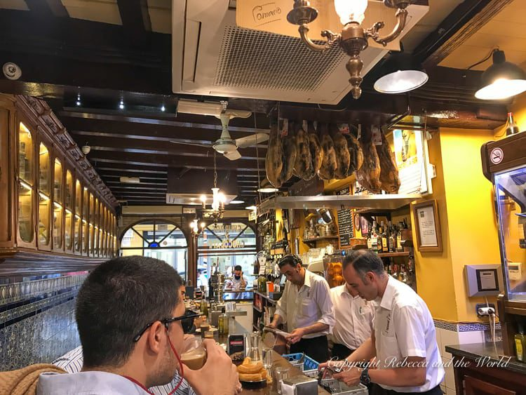 Make sure to stop by Bar El Comercio to try the best churros and hot chocolate in Seville