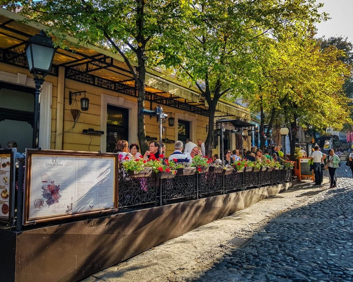One of the best things to do in Belgrade is sip on coffee in a traditional coffee house on Skadarska Street