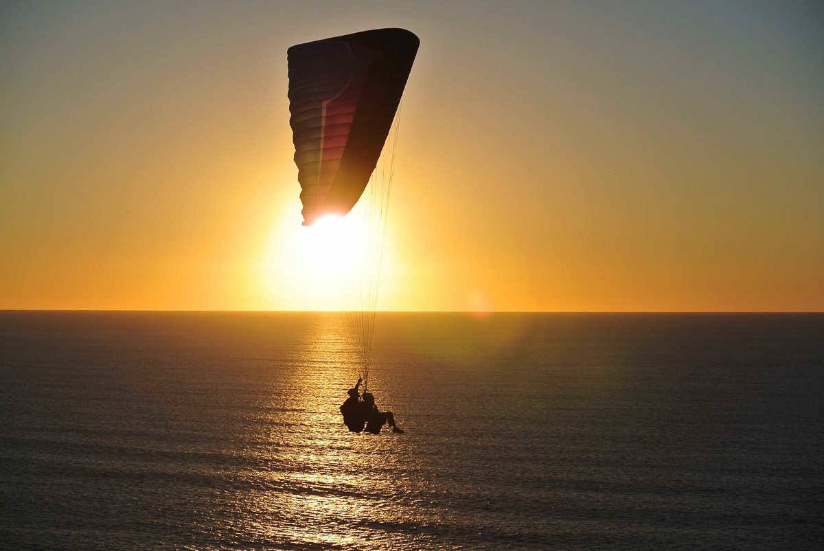 The are plenty of great beachy things to do in San Diego, including paragliding