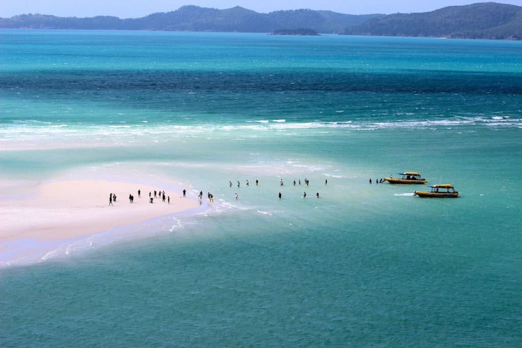 The Whitsunday Islands are some of the most beautiful islands in Australia. Just off the coast of Queensland, you can visit them on a sailing trip