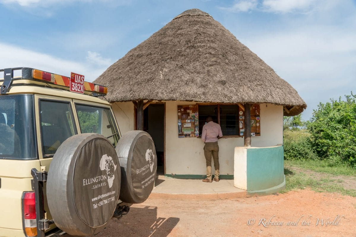 One of the reasons why you should hire a private guide for a safari in East Africa is because they'll do all the organising - here's Shaun arranging yet another national park entrance permit