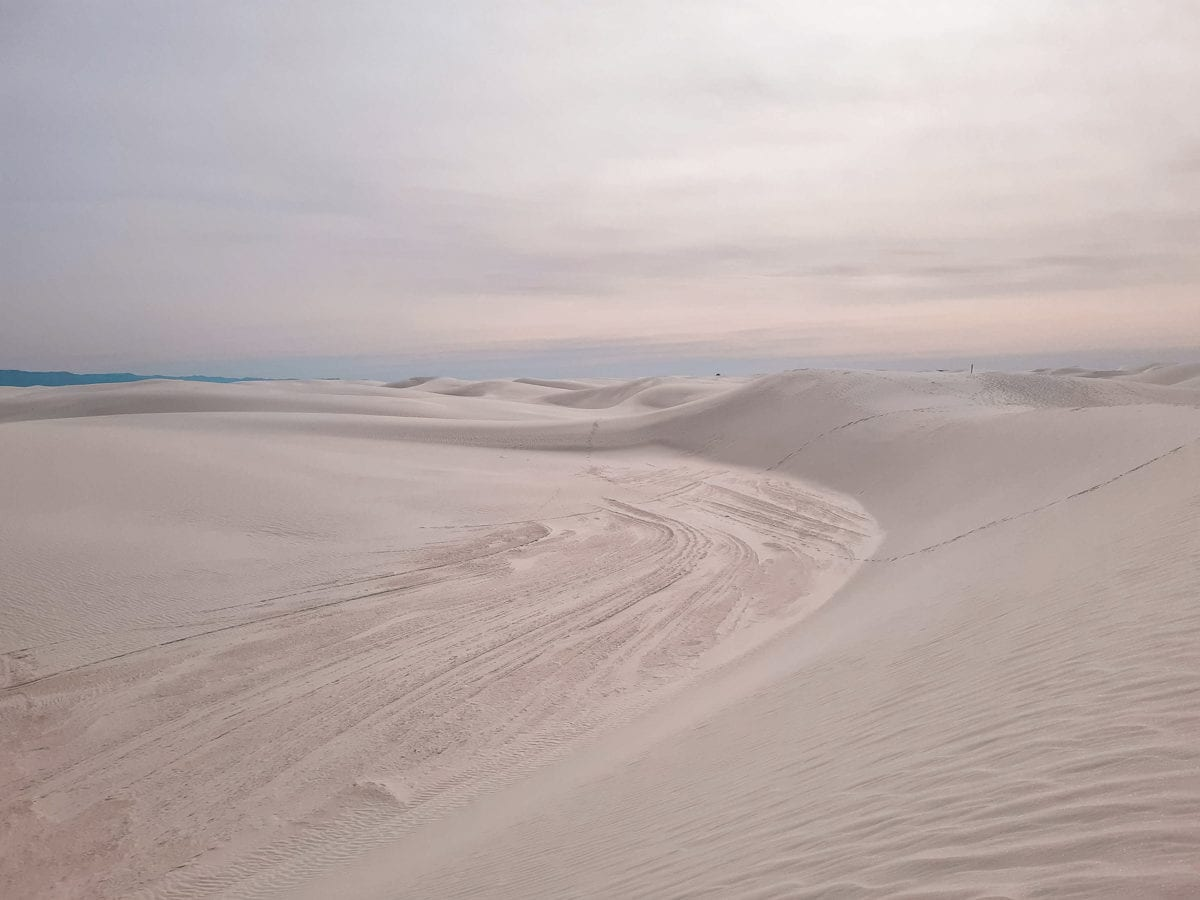 White Sands National Park is one of the more unique places to visit in the US - here you can go sand boarding on the dunes!