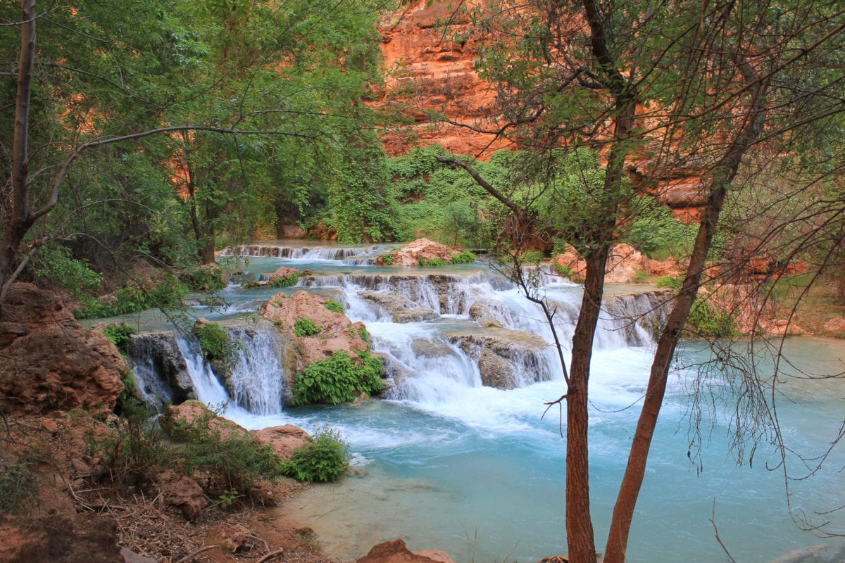 One of the most beautiful places to visit in America is Havasupai Falls - you'll need to plan well ahead to reserve permits