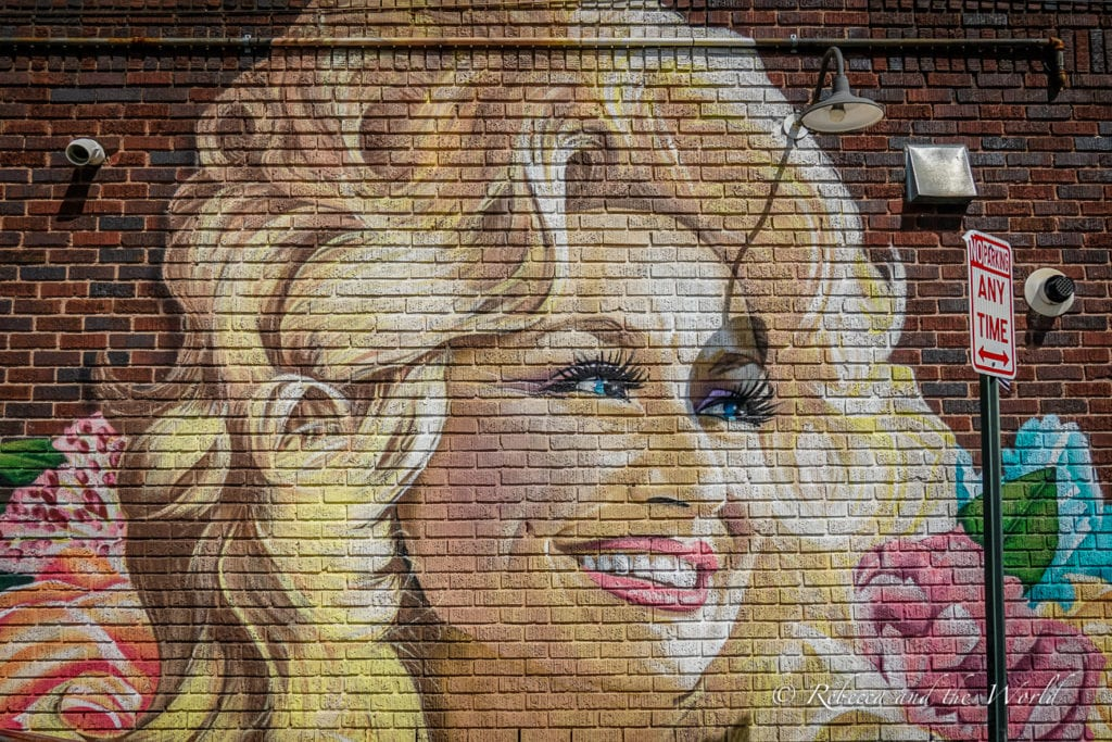 Dolly Parton is from the South and you can see her in murals and at Dollywood